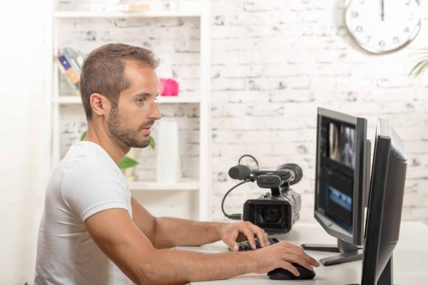 technician video editor on the computer with video camera